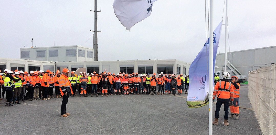Lifting the Blue Label flag at the life base