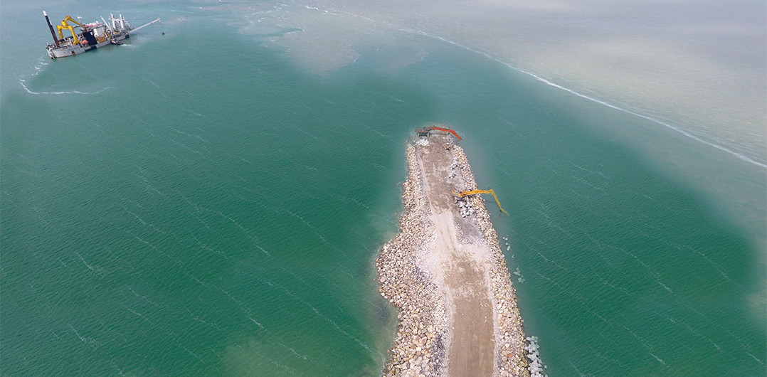 At the end of the main breakwater under construction
