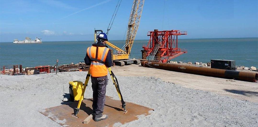 A surveyor on the Eastern inner embankment